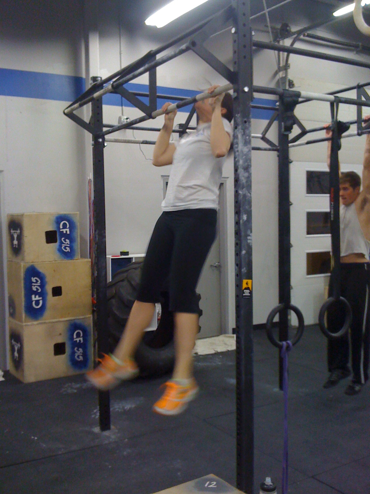 Hanging knee raises with medicine ball - February Cool Board